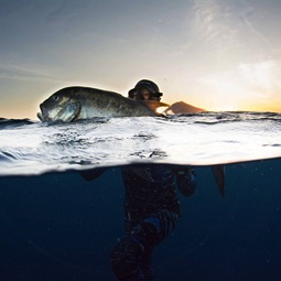 Andrea De Camilli with a Giant Trevally in Indonesia